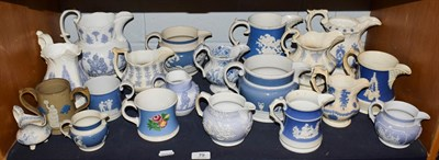 Lot 79 - A group of early 19th century English sprigged pottery jugs of varying designs and size...