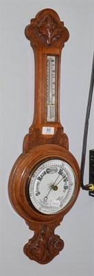 Lot 93 - An oak cased aneroid barometer