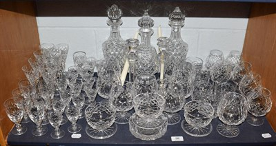 Lot 98 - A mixed suite of crystal drinking glasses etc, to include three decanters, Waterford brandy...