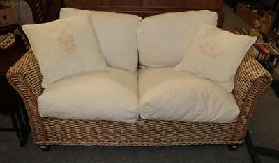 Lot 1057 - A rattan sofa 160cm wide