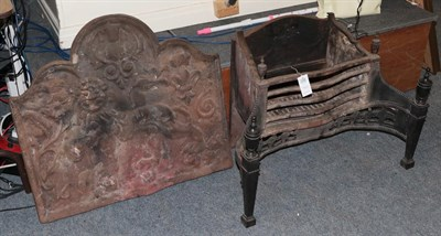 Lot 1058 - A 19th century cast iron fire back decorated in relief with lion passant below a thistle,...