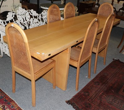 Lot 1060 - A modern Italian bleached oak dining table, the 7ft 5'' rectangular top with two fold out...