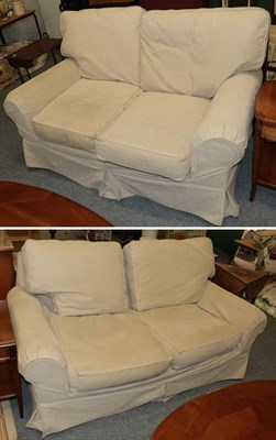 Lot 1063 - A Laura Ashley three seater sofa in cream fabric 180cm long, together with a matching two...