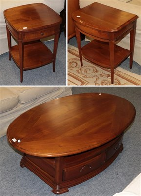 Lot 1064 - A modern yew wood coffee table 130cm by 80cm by 45cm, together with two similar bedside tables both