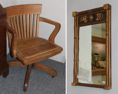 Lot 1072 - An oak 1920's desk chair with a swivel action and a gilt wood Regency style wall mirror 49cm by...