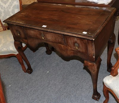 Lot 1079 - A George III cross banded mahogany lowboy on ball and claw feet 99cm by 48cm by 76cm
