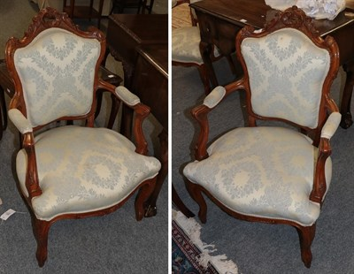 Lot 1080 - A pair of French style gilt carved salon armchairs