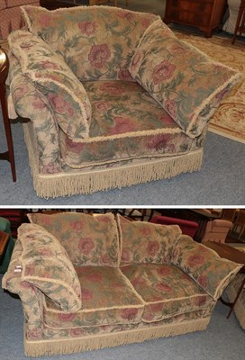 Lot 1084 - A chenille upholstered two-seater settee with bolster cushions and in stylised floral design, 193cm