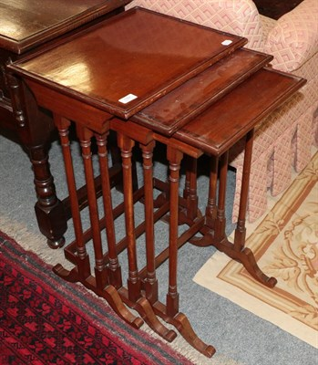 Lot 1091 - A nest of three cross banded mahogany spider leg tables 48cm by 38cm by 74cm (largest)