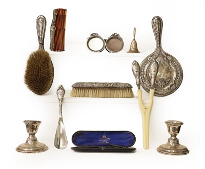 Lot 5 - A tray of silver items including a pair of dwarf candlesticks, silver mounted spectacles case...