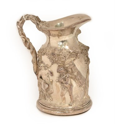 Lot 24 - A Silvered Wine Jug, in the Regency style, heavily cast with Bacchic putto among fruiting...