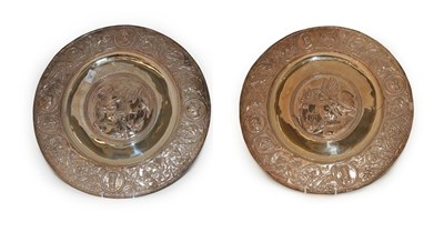 Lot 35 - A Pair of Silver Plate Sideboard-Dishes, each circular, chased with a classical figure in the...