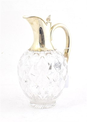Lot 54 - A Victorian Silver-Mounted Glass Claret-Jug, by John Grinsell and Sons, London, 1897. The...