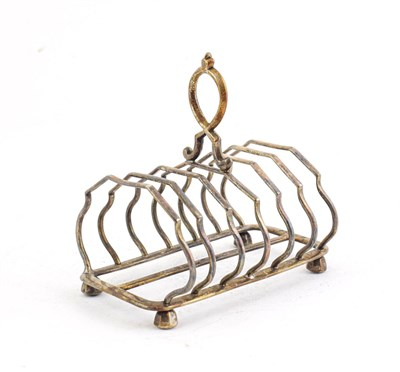 Lot 56 - A Victorian Silver Toast rack, by Edward Hutton, London, 1891, oblong and with seven bars and...