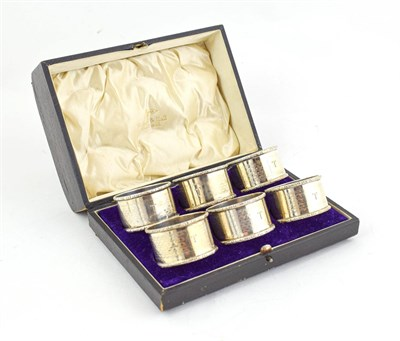 Lot 86 - A Cased Set of Six Napkin Rings Four by Henry Matthews, Birmingam, 1918 and 1919, one by Walker and