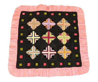Lot 2009 - An Early 20th Century Decorative Patchwork Cushion Cover/Panel, worked in black, pink and other...