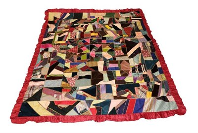 Lot 2011 - A Late 19th Century Crazy Patchwork Bed Cover, incorporating coloured velvets, silks, silk...