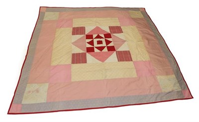 Lot 2014 - Victorian Patchwork Cover, incorporating a central red and white block, framed by a pink...