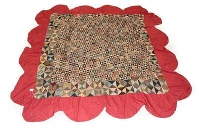 Lot 2015 - A Late 18th Century Patchwork Coverlet, comprising 4cm squares to the centre which are made up...