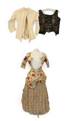 Lot 2048 - A 19th Century Dress printed with large flowerheads in pink and ochre, comprising a fitted...