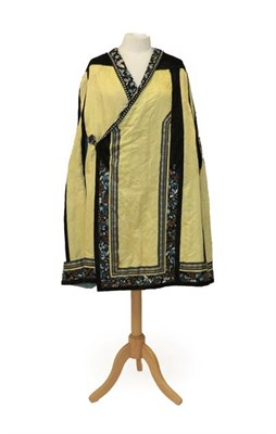 Lot 2049 - Early 20th Century Chinese Yellow Silk Brocade Cape with black silk shoulders, applied, embroidered