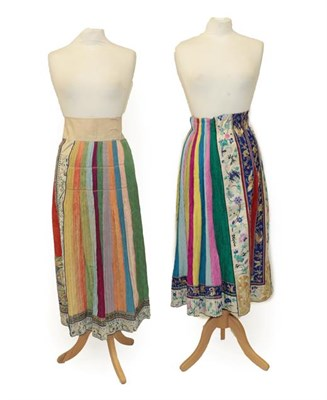 Lot 2050 - An Early 20th Century Chinese Embroidered Silk Skirt Panel, in figured silk of yellow, red,...