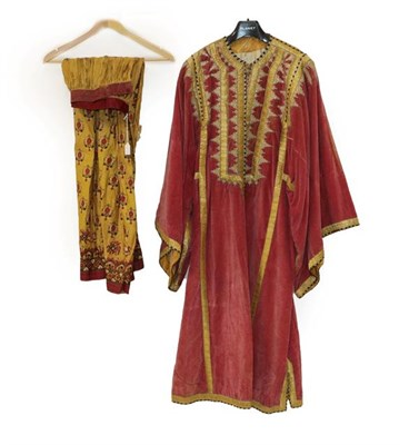 Lot 2051 - Early 20th Century Pink Velvet Eastern Robe, with decorative appliquéd gold trims and stylised...