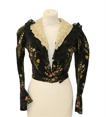 Lot 2052 - A Late 19th Century Black Silk Brocade Jacket, woven with tulips in red, yellow, and mauve,...