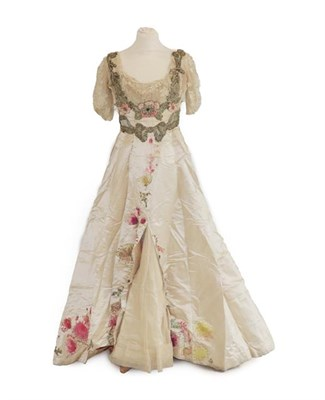 Lot 2053 - A Late 19th Century Ladies' Evening Dress, in cream silk with short net and lace pleated...