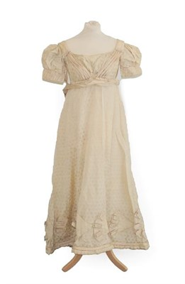 Lot 2054 - A19th Century Cream Silk Short Sleeve Dress woven with leaves, military style cream silk straps and