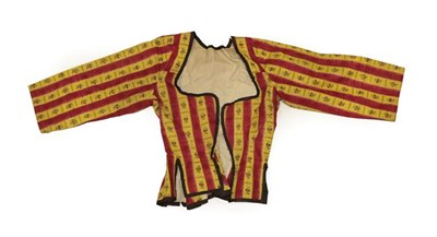 Lot 2064 - An Early 19th Century Caraco, in a glazed cotton printed with red and yellow stripes printed with a