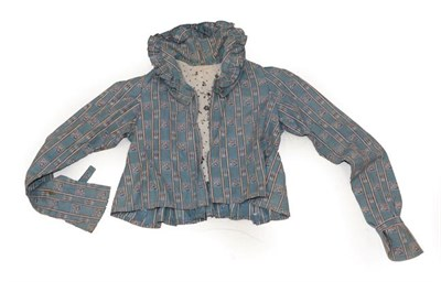 Lot 2065 - Early 19th Century Caraco, in a blue cotton printed with floral and ikat design in alternating...