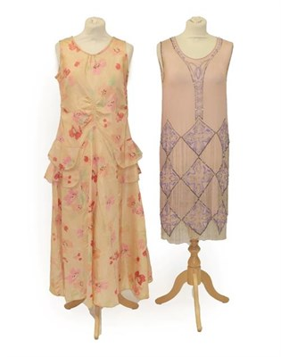 Lot 2074 - Circa 1920sPale Pink Crepe Sleeveless Flapper Dress, with scooped neckline, appliquéd with...
