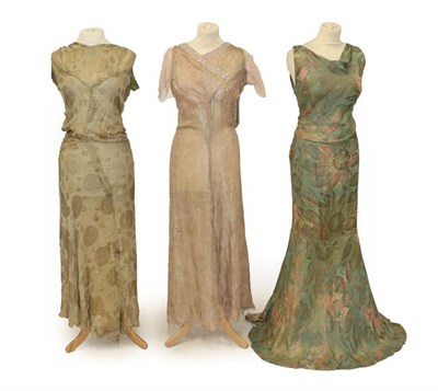 Lot 2075 - Circa 1930 Blue Floral Lamé Evening Dress, sleeveless with cowl neck, long skirt and open...