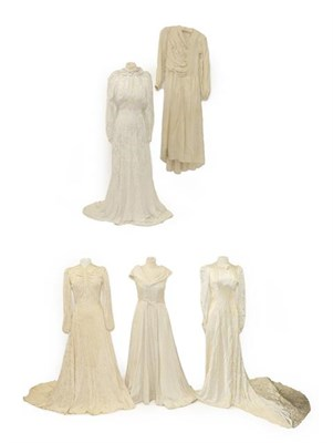 Lot 2078 - Circa 1940 and Later Wedding Dresses, comprising a cream brocade dress with a train, multi...