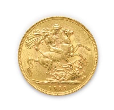 Lot 4042 - George V (1910 - 1936), 1911 Sovereign. Obv: Bare head of George V left, B.M. below truncation...