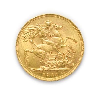 Lot 4043 - George V (1910 - 1936), 1911 Sovereign. Obv: Bare head of George V left, B.M. below truncation...