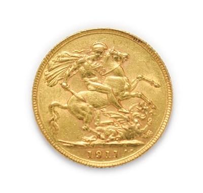 Lot 4045 - George V (1910 - 1936), 1911 Sovereign. Obv: Bare head of George V left, B.M. below truncation...