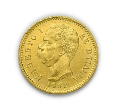 Lot 4072 - Italy, Umberto I (1878 - 1900), 1882 R Twenty Lire. 6.45g of .900 gold. Rome mint. Obv: Bare...