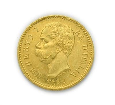 Lot 4073 - Italy, Umberto I (1878 - 1900), 1882 R Twenty Lire. 6.45g of .900 gold. Rome mint. Obv: Bare...