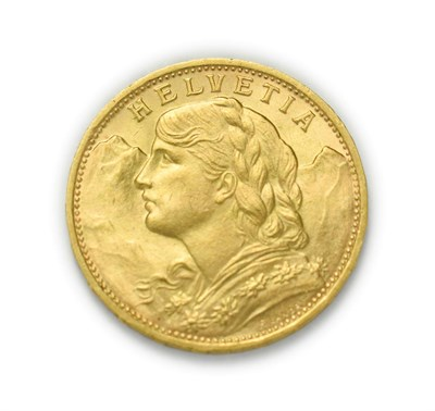 Lot 4084 - Switzerland, 1930 B Twenty Francs. 6.45g of .900 gold. Bern mint. Obv: Bust of young woman from...