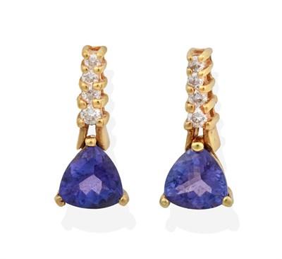 Lot 2001 - A Pair of Tanzanite and Diamond Drop Earrings, four graduated round brilliant cut diamonds...