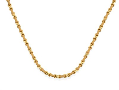 Lot 2002 - An 18 Carat Gold Fancy Link Chain, the yellow textured rectangular links spaced by plain...