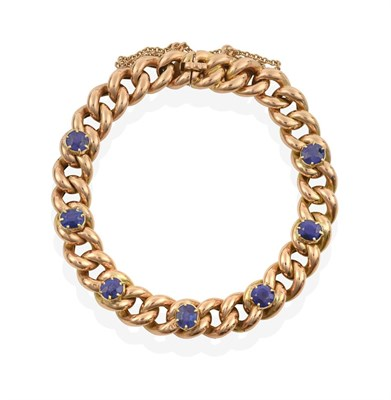 Lot 2005 - A Sapphire Bracelet, the yellow curb link bracelet with seven oval cut sapphires spaced evenly...