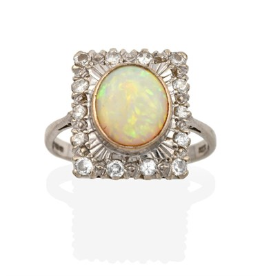 Lot 2008 - An 18 Carat White Gold Opal and Diamond Cluster Ring, the plaque set throughout with eight-cut...