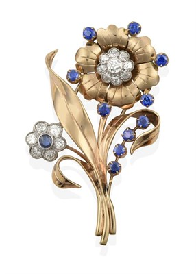 Lot 2009 - A Sapphire and Diamond Floral Brooch, circa 1940s, one flower formed of a round cut sapphire within
