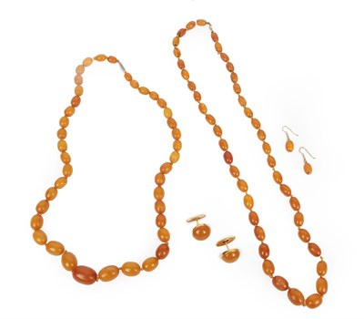 Lot 2012 - Two Amber Bead Necklaces, formed of forty-one and forty-four graduated amber beads, lengths...