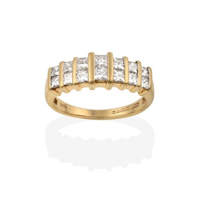 Lot 2017 - A 14 Carat Gold Diamond Half Hoop Ring, the two rows of graduated princess cut diamonds spaced...