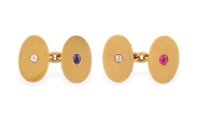 Lot 2019 - A Pair of Gem Set Cufflinks, the yellow chain linked oval plain polished plaques each inset...
