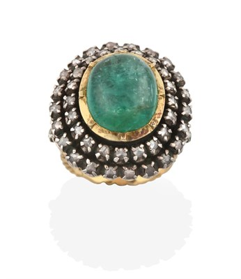 Lot 2021 - An Indian Emerald and Diamond Cluster Ring, the oval cabochon emerald in a yellow collet...